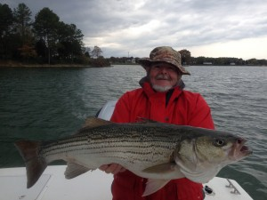 John with a nice November Striper....jigged up on light tackle!