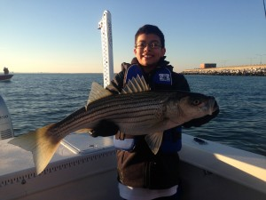 """Benji Started the day with a 30"""" Striper on his first cast!  He caught many other nice ones along with some Red Drum!  Great job Benji!!!!!"""