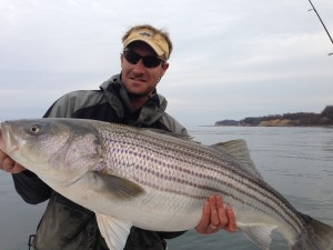 Jon with a huge light tackle jigged Striper!