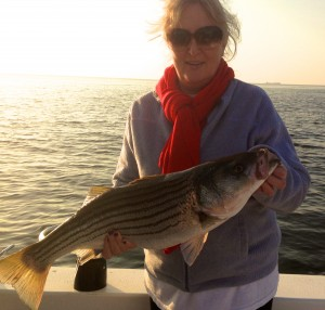 Here's Anna with a real nice striper caught on her FIRST cast!  Doesn't get any better than that!!!