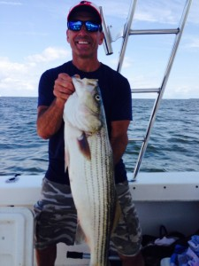 My buddy Dan with a huge summer striper