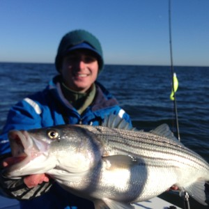 "Jon with a 34""er!!!  Nice light tackle Striper!!!"