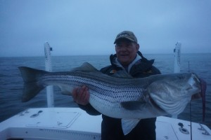 "Dave's early morning whopper!  43""er caught on a 10"" BKD on a Hardhead Custome Baits 2 ounce chartruese and white jighead."