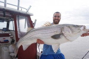 Luke with a huge light tackle winter Striper